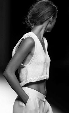 Cute.  Love the angle of the cutoff top, and the fabric.   Like her hairstyle, too.