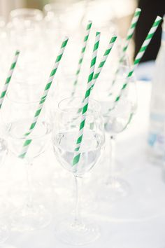 Pretty Emerald Green Garden Wedding: Zoé &  Rene Straws are a great way to add a pop of color and fun to your reception tables..who doesn't love straws