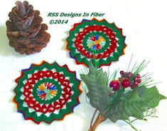Set of 2 Crochet Coasters in Red and Green Lace Design - Handmade Crochet by RSS Designs In Fiber Crochet Lace Doilies - 5 1/4 Inch Diameter Coaster Size -- Garnet Red Petals (Textured Feature) in-between Christmas Green with Multi-Color Center and Border. Each piece is 5 1/4