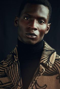Total no-nonsense look. Love the patterning on the coat, and yes - the turtleneck is alive and well. Some cat named Adonis Bosso by Nacho Alegre.