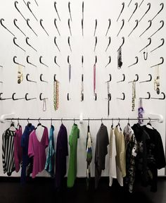 Kokoo Boutique, Nicosia. Embedded umbrellas as clothes hangers