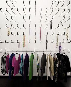 Kokoo Boutique, Nicosia. Embedded umbrellas as clothes hangers
