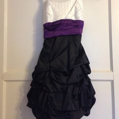 Black, white, and purple formal dress☂ Adorable dress with sparkles on the front of the white part of the dress. Ruffles on the bottom. Zipper in back. Lined and slightly padded. *straps made from ribbon were sewn on for extra support. Can easily be cut off.* Ruby Rox Dresses