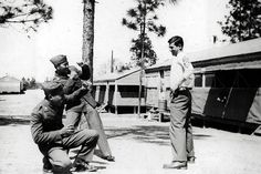 My dad showing off to his friends at Camp Shelby in Hattiesburg, Mississippi