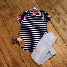 Melody Striped Top is comfort and sporty style. Full round neckline with a classic navy and ivory striped bodice and short raglan sleeves in a beautiful floral print.
