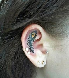 Unique Feather Tattoo Designs Ear, peacock feather tattoo meaning, feather tattoos meaning S Tattoo, Piercing Tattoo, Body Art Tattoos, Ear Tattoos, Tiny Tattoo, Tatoos, Swahili Tattoo, Inner Ear Tattoo, Girly Tattoos