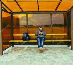 Joyful Young Man Waiting Transport Bus Stop Male Sitting Bench - Stock Ph , Sitting Bench, Man Sitting, Transport Bus, Bus Stop, Young Man, Birds In Flight, Photo Library, Transportation, Waiting
