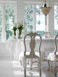 Shabby chic white dining room.