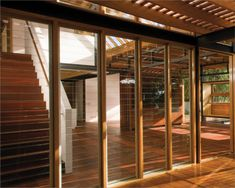 A timber-floored room has walls made up of louvred windows allowing in natural light Shop Interior Design, House Design, Timber Sliding Doors, Louvre Windows, Traditional Bowls, Passive Design, Energy Efficient Windows, Healthy Environment, Shop House Plans