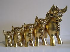 Set of 5 gold leafed bulls from Lima, Peru.