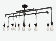 Industrial Custom Rustic Pipe and Cloth Cord Chandelier- 12 Light on Etsy, $1,599.00