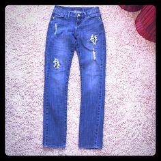 "Rock & Republic distressed with rhinestones Rock & Republic skinny jeans with distressed look and rhinestone detailing through exposed rips. Super cute jeans. Size 4, 30"" inseam Rock & Republic Jeans Skinny"