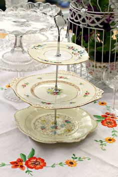 Vintage Cakestand. Love the tablecloth, too.