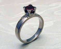 Art Deco engagement ring, ruby with pave diamonds. Contemporary art deco style engagement ring with ruby in fishtail setting and diamonds pave set. Garra, Cute Engagement Rings, Art Deco Stil, Contemporary Engagement Rings, Pretty Rings, Ring Verlobung, Birthstone Jewelry, Art Deco Fashion, Celtic