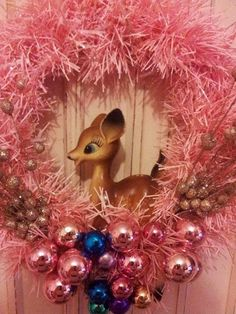 Pink kitsch Christmas wreath with vintage deer.