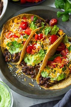 I know what most of you are probably thinking. Black bean tacos. BORING! My family was thinking the same thing until I made them these seriously delicious
