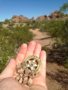"""Treasure in the desert.  Original uploader: """"I took this photo of the Texas S Geocoin I uncovered during a recent visit to Arizona. How did it get to the desert? Geocaching... the ultimate adventure!""""  #IBGCp"""