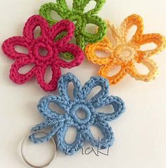 Ready to make your 5 minutes flower?!    This flower is very easy and quick you'll be amazed!   Great way to use all those scraps of yarn that we all have!   Use them to embellish your project or make a key chain and make someone happy in JUST 5 MINUTES!!!!     …