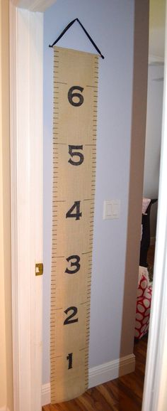 Burlap Family Growth Chart - uses paper round tags and safety pins to record measurements.