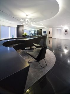 DL Piper, Perth. Curved, alcove lighting, curved glossy floor treatment in reception area