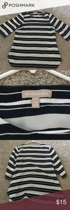 Banana Republic Striped Top Excellent condition Banana Republic striped light weight top. 100% polyester. 3/4 sleeve size XS Colors are white and Navy Banana Republic Tops Blouses