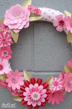 Make a gorgeous paper flower wreath with the Cricut. Perfect for holiday decor or just because.