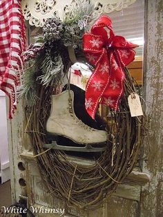 Prim Twiggy Christmas Wreath...with old ice skates, pine & red bow.
