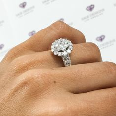 This unique statement ring features a cluster of natural white diamonds in 18k white gold.
