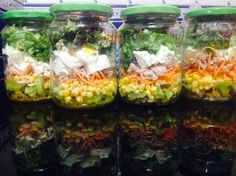 #MasonJarSalad  Salad:(bottom to top): golden raisins, kiwi, purple onion, sliced carrot, corn, tuna, boiled egg, feta cheese, lettuce, coriander, onion croutons. Salad dressing: olive oil, lemon, salt and pepper.