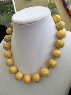 A personal favorite from my Etsy shop https://www.etsy.com/listing/294815127/yellow-beaded-necklace-with-gold-leaf
