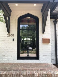 Custom iron front doors transform the design of any entrance. With large glass windows to let in all the natural light, this modern, contemporary entry takes all of your exterior door ideas to the next level. Awning Over Door, Custom Exterior Doors, Custom Front Doors, Front Doors With Windows, House Entrance, Modern, Modern Entryway, Iron Front Door, Glass Panel Door