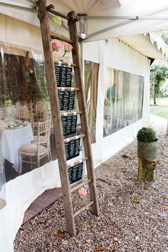 creative rustic table plan on a ladder. Ireland wedding