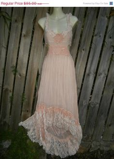 shes a vintage inspired pink chiffon dress kissed with ruffles of pink lace,crochet doilies,cut out detail on the sides and back and shabby detail with