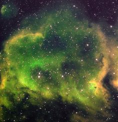 Glowing ominously green and yellow in this picture, the nebula W5 - nicknamed (seriously) the Soul Nebula - peers into your soul with its bl...