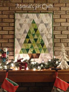 "Lovely ""O' Christmas Tree"" wall hanging by Amanda Castor from Material Girl Quilts.  ""For the quilting I used #Aurifil 50 wt. 2600 (the best gray to blend with everything!) and echoed approximately 1/4″ on either side of the diagonal seams. I'm so happy with how it turned out even if none of the points match up! It makes me smile and that's what matters I guess  ""  To see more please visit https://materialgirlquilts.wordpress.com/2014/12/05/o-christmas-tree-a-finished-quilt/"