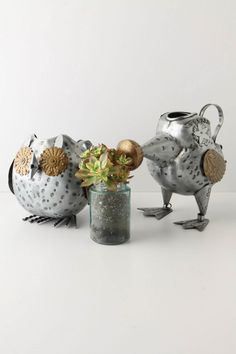 Watering Cans with a Steampunk vibe from Anthropologie....(I have the owl and he's really cute and heavy duty)