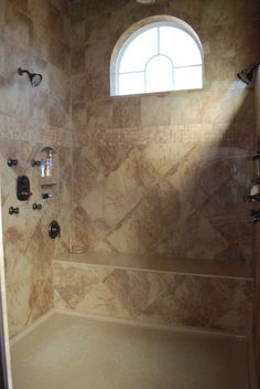 Steam shower with two entrances to allow one to exit into a drying room with warming lights,towels and lotions at your finger tips. This space leads directly into the closet