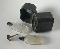 Flaconnier containing two glass bottles and a small funnel (for perfume, spirits?), Europe, 18thC, leather, silver, crystal, copper, silk | Centre de documentation des musées - Les Arts Décoratifs