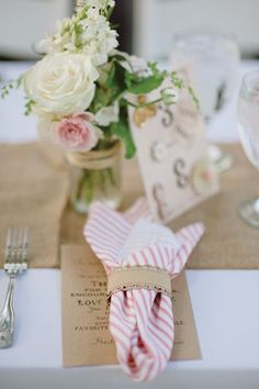 pink + white striped napkins with burlap runners and soft colored flowers