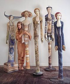 Camille Vanden in her studio with her life size sculptures