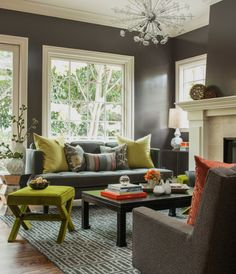 Gray living room with chartreuse and salmon accents.  Love the sparkle the pendant light adds.