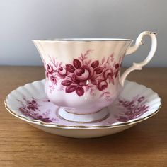 """Royal Albert Vintage Teacup and Saucer Melody Series """"Serenade"""" This is a beautiful Montrose shaped teacup and saucer trimmed in gold. This set is half white and half light pink with dark pink roses and leaves. This set would compliment any collection. This is one in a series of six! (The"""