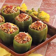 Mexican-Style Stuffed Peppers Recipe. Just make these - really good! I used spicy taco seasoning instead of chili powder and omitted the green chilies.