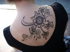Attractive Black Henna Flowers Tattoo On Upper Back By Cheers