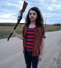 25 Idiots With Guns | SMOSH- Problem? It isn't a baseball bat or a club. Solution: Your holding the gun wrong. Second problem the guys an idiot to begin with asking to get shot, don't try this at home.