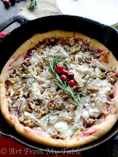 Try changing up the usual Thanksgiving leftovers for this fabulous Turkey Cranberry Pizza Recipe with goat cheese, walnuts and fresh rosemary.