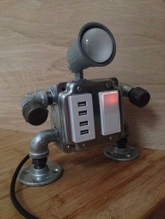 """Handmade """"industrial robot"""" lamp design with 4 functioning USB outlets and illuminated decora style switch. This lamp is handmade in my Brooklyn studio. (and is awesome) Metal Projects, Welding Projects, Home Projects, Pipe Lighting, Industrial Lighting, Industrial Pipe, Industrial Robots, Edison Lighting, Vintage Industrial"""