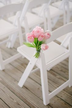 pink tulips on the ceremony chairs | Britt Croft