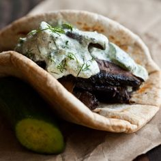 The perfect summer sandwich- marinated portobello gyros topped with a tangy raw hemp seed tzatziki sauce, wrapped in fluffy pita bread.