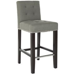 This beautiful gray counter stool is perfect for a stylish living room bar or breakfast counter. The nailhead trim and gray upholstery give it both a casual and sophisticated look that will match a myriad of themes and color schemes.